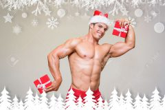 31865907-shirtless-macho-man-in-santa-hat-holding-gifts-against-fir-tree-stock-photo